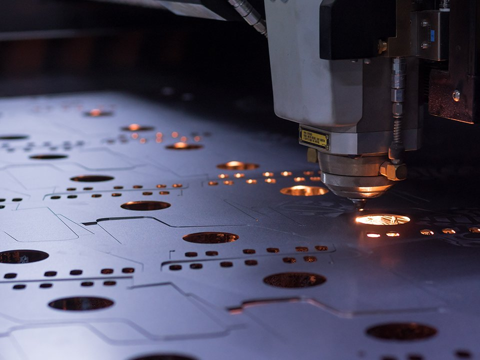 Laser Jet cutter cutting fabricated metal parts for assembly.